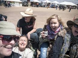 Photo by Alison DeLapp: Carla King, Alison DeLapp, Sandy Borden, Martha Forget, Lisa Thomas riding a Ural at the Overland Expo